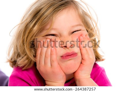little girl in front of white background is bored