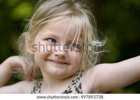 Little girl in funny pose