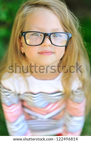 Little girl in glasses - closeup portrait - stock photo