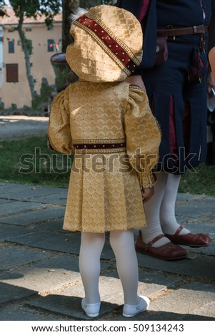 Little Girl in Golden Uniform with Big Hat during Parade