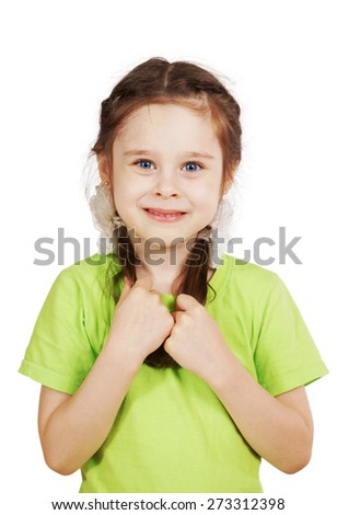 Little girl in green t-shirt holding her pigtails - stock photo