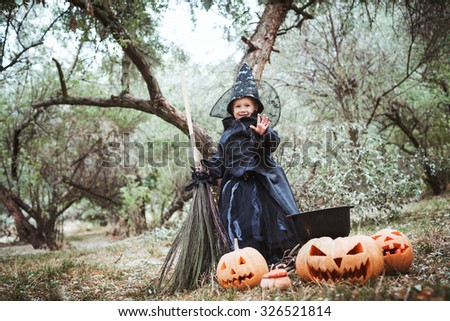 little girl in halloween witch costume - stock photo