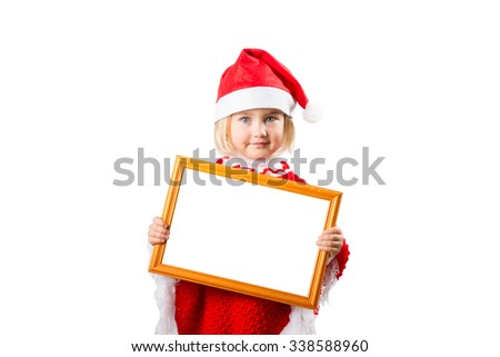 Little girl in hat Santa Claus holding frame with a white background for the text. - stock photo