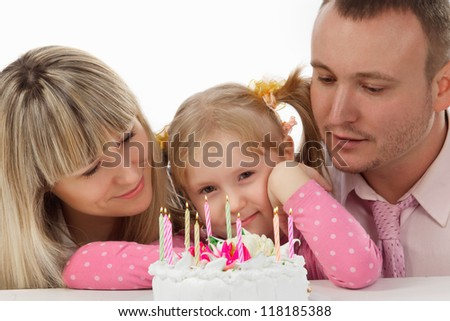 Little girl in her birthday with her happy family - stock photo