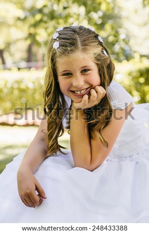 Little Girl in her First Communion Day - stock photo
