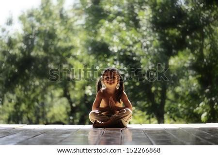 little girl in lotus position - stock photo