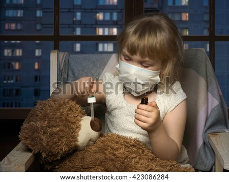 Little girl in medical mask dripping drops a toy bear. The house, in the evening, the windows of houses, the city. Conceptually about diseases, infections and allergies - stock photo