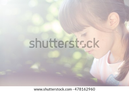 Little girl in morning sun