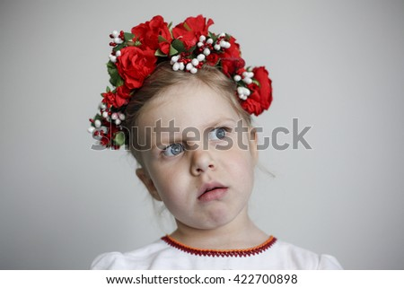Little girl in national Ukrainian dress, embroidered shirt - stock photo