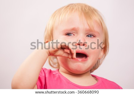 Little Girl in pink crying