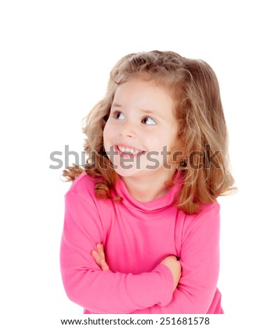 Little girl in pink looking at side isolated on a white background - stock photo