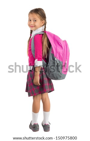 Little girl in pink school uniform with a backpack looking over left shoulder and smiling, isolated - stock photo