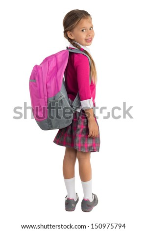 Little girl in pink school uniform with a backpack looking over right shoulder and smiling, isolated - stock photo