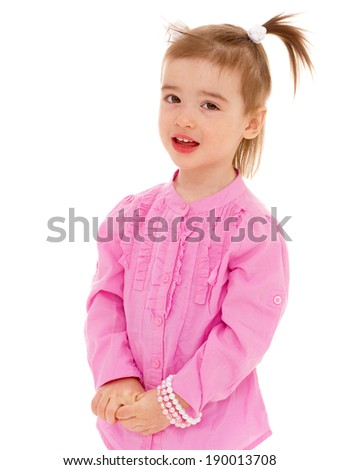 Little girl in pink shirt smiling and looking up - stock photo