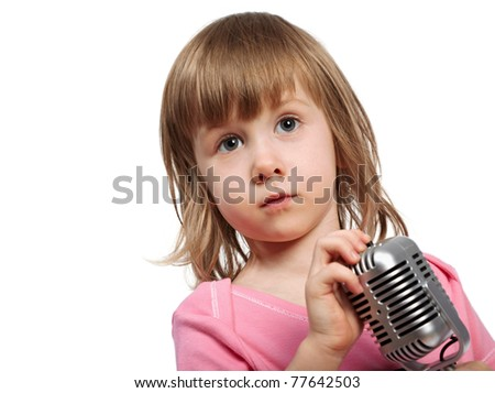 Little girl in pink with microphone. - stock photo