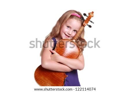 little girl in purple dress hugging violin - stock photo