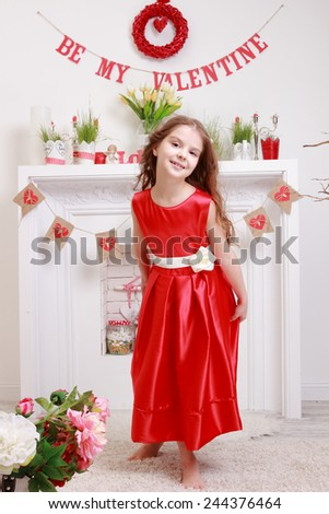 little girl in red dress over valentine day background - stock photo