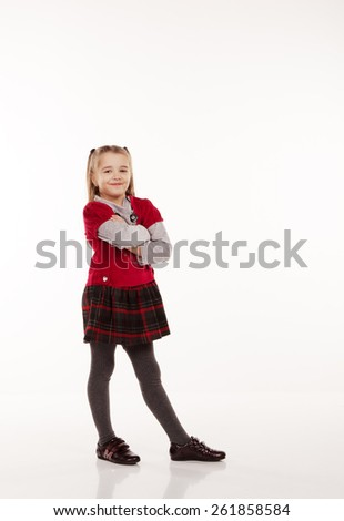 little girl in red dress posing standing