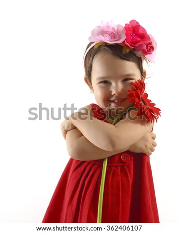 little girl in red dress with a gerber bouquet in her hand
