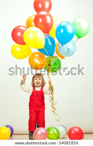 little girl in red jumping with balloons - stock photo