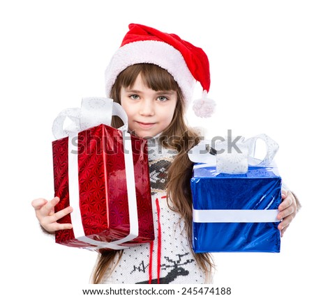 little girl in red santa hat and gift boxes. isolated on white background - stock photo
