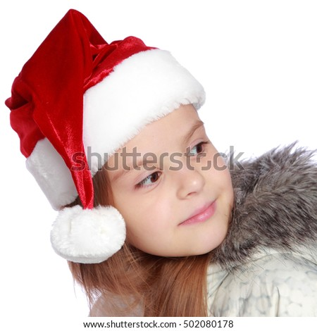 Little girl in red santa hat on white background