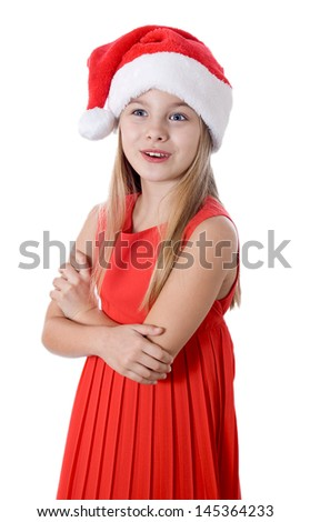 little girl in red santa hat on white background. portrait