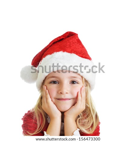 little girl in red santa hat on white background. portrait - stock photo