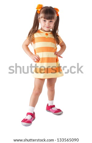 little girl in red shoes. Isolated on white background. - stock photo