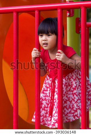 Little Girl in red skirt enjoy in the park.
