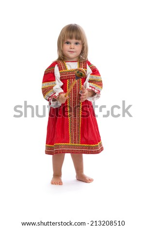 Little girl in red traditional dress with a wooden spoon. Isolate on white.