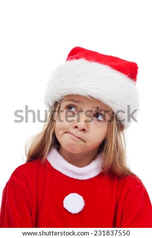 Little girl in santa claus outfit thinking in doubt - isolated, closeup - stock photo