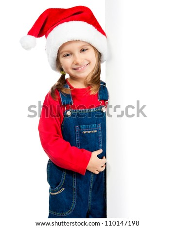 little girl in santa hat behind the board - stock photo