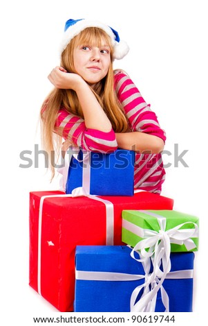 Little girl in Santa's hat with blue gift box isolated on white - stock photo