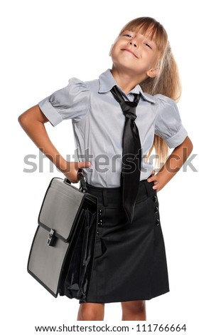 Little girl in school uniform with briefcase isolated on white background - stock photo