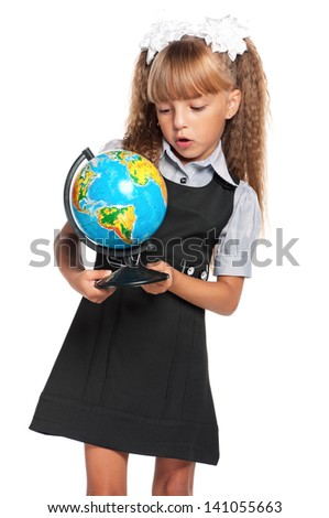 Little girl in school uniform with globe of the world isolated on white background