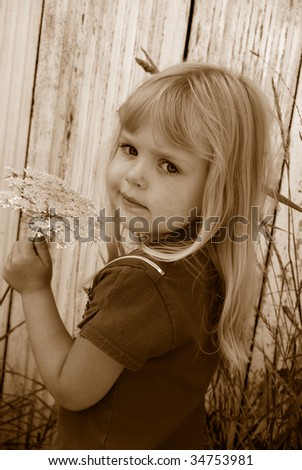 little girl in sepia with queen anne's lace