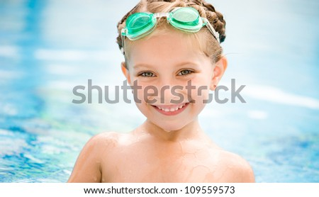 Little girl in swimming pool close-up.