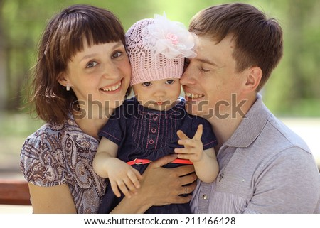 little girl in the arms of his father walk - stock photo