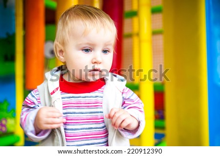 little girl in the classroom early development plays with toys - stock photo