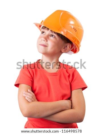 Little girl in the construction helmet looking up