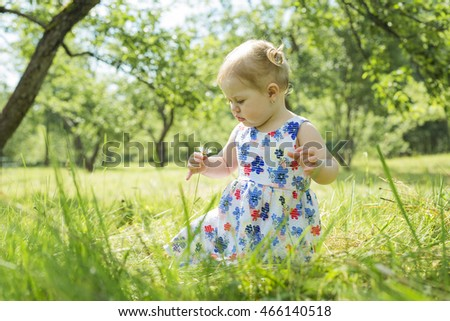 Little girl in the forest park