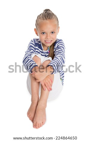 Little girl in the form of a sailor boy. Girl is six years old. - stock photo