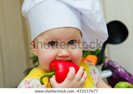 Little girl in the kitchen with vegetables, preparing vegetables to make soup