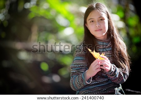Little girl in the park - stock photo