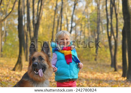 little girl in the park their home with a dog. - stock photo