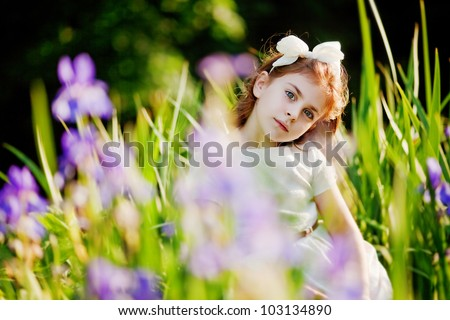 Little girl in the summer garden
