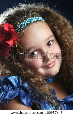 little girl in the Ukrainian national dress with yellow flowers - stock photo