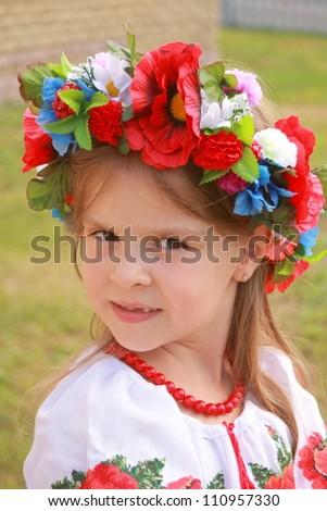 little girl in traditional ukrainian costume/outdoor portrait wears historical costume - stock photo