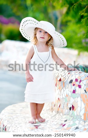 little girl in white big hat in summer  - stock photo